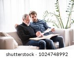 hipster son and his senior... | Shutterstock . vector #1024748992