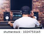 back of asian sound engineer... | Shutterstock . vector #1024753165