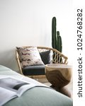 cozy armchair with real cactus...   Shutterstock . vector #1024768282