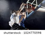 two basketball players in... | Shutterstock . vector #1024770598