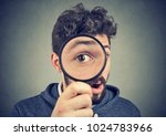 curious amazed young man...   Shutterstock . vector #1024783966