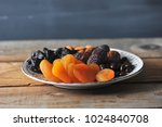 plate with dried fruits and... | Shutterstock . vector #1024840708
