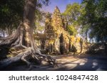 ancient gates of bayon temple... | Shutterstock . vector #1024847428