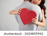 happy woman holding heart... | Shutterstock . vector #1024855942