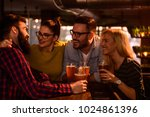 friends in the pub. drinking... | Shutterstock . vector #1024861396