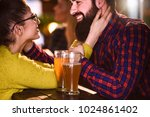 friends in the pub. drinking... | Shutterstock . vector #1024861402