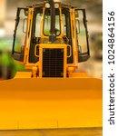 Small photo of Yellow front bucket of heavy crawler excavator