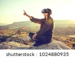 woman with glasses of virtual... | Shutterstock . vector #1024880935