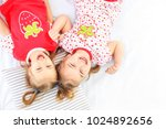 two children lie in a pajamas... | Shutterstock . vector #1024892656