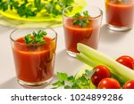 three glasses of tomato juice... | Shutterstock . vector #1024899286