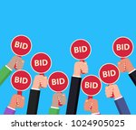hand holding auction paddle.... | Shutterstock .eps vector #1024905025