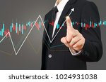 investment concept hand with... | Shutterstock . vector #1024931038