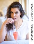 young beautiful woman drinking... | Shutterstock . vector #1024939936