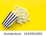 popcorn in paper bag scattered... | Shutterstock . vector #1024961002