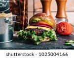 cheeseburger on a pretzel bun... | Shutterstock . vector #1025004166