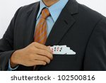 Businessman with four ace cards - stock photo