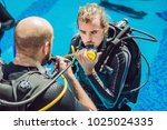 diving instructor and students. ... | Shutterstock . vector #1025024335