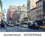 city life and traffic on... | Shutterstock . vector #1025059666