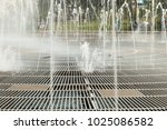 Water From A Fountain In The...