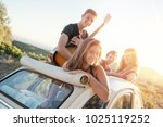 group of happy people in a car... | Shutterstock . vector #1025119252