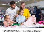 positive parents choosing new... | Shutterstock . vector #1025121532
