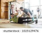 fitness trainer giving... | Shutterstock . vector #1025129476