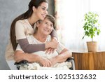 caring and smiling woman... | Shutterstock . vector #1025132632