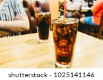 image of cola in glass with ice ... | Shutterstock . vector #1025141146