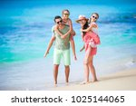 happy beautiful family of four... | Shutterstock . vector #1025144065