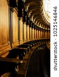 Small photo of Antique wooden choir seating stalls in a baroque chapel in italy