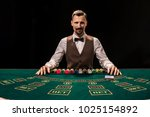Portrait of a croupier is...