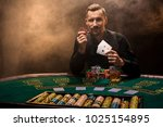 handsome poker player with two... | Shutterstock . vector #1025154895