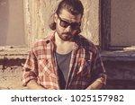 man with beard and long hair... | Shutterstock . vector #1025157982