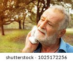 senior man tired wiping sweat... | Shutterstock . vector #1025172256