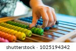 hand counting on colorful abacus | Shutterstock . vector #1025194342