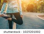 women sport jogging on road in... | Shutterstock . vector #1025201002