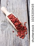 Goji Berries In Wooden Spoon ....