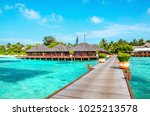 Wooden Pier And Exotic Bungalo...