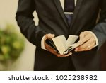 reading the book. bible book.... | Shutterstock . vector #1025238982