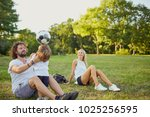 family playing with a ball in...   Shutterstock . vector #1025256595