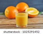 glass with fresh orange juice...   Shutterstock . vector #1025291452
