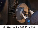 the man is repairing the disc... | Shutterstock . vector #1025314966