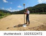 professional land surveyor... | Shutterstock . vector #1025322472