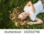 Girl Laying In A Grassy Field...