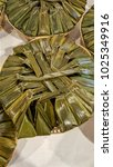 Small photo of Steamed Flour with Coconut Filling wrapped by banana and coconut leaves. In Thailand called Kanom Sai Sai