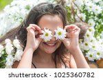 child with daisy eyes  on green ... | Shutterstock . vector #1025360782