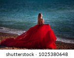 beautiful girl by the sea. a... | Shutterstock . vector #1025380648