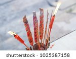 burning incenses and red... | Shutterstock . vector #1025387158