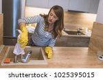 close up of woman wiping... | Shutterstock . vector #1025395015