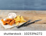 fried fish sticks with sauce...   Shutterstock . vector #1025396272